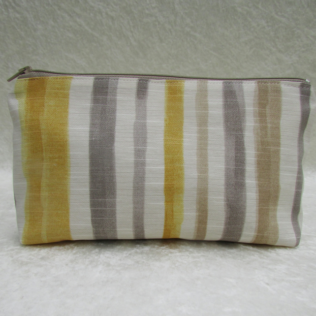 Striped cosmetic bag in golden yellow, grey, white and beige