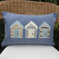 Beach huts cushion - Rectangular, blue with cream, pale blue and gold huts