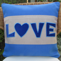 "SALE - Bright blue ""Love"" appliqued cushion"