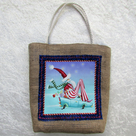 Christmas gift bag in hessian with fabric panel featuring Santa on a toy car