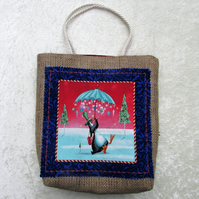 Christmas gift bag in hessian with fabric panel - penguin with umbrella