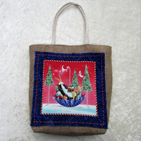 Christmas gift bag in hessian with fabric panel - penguin in upturned umbrella