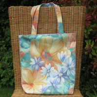 Tote bag with orange, blue and green floral pattern