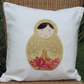 Russian doll cushion - cream with gold and pink Russian doll