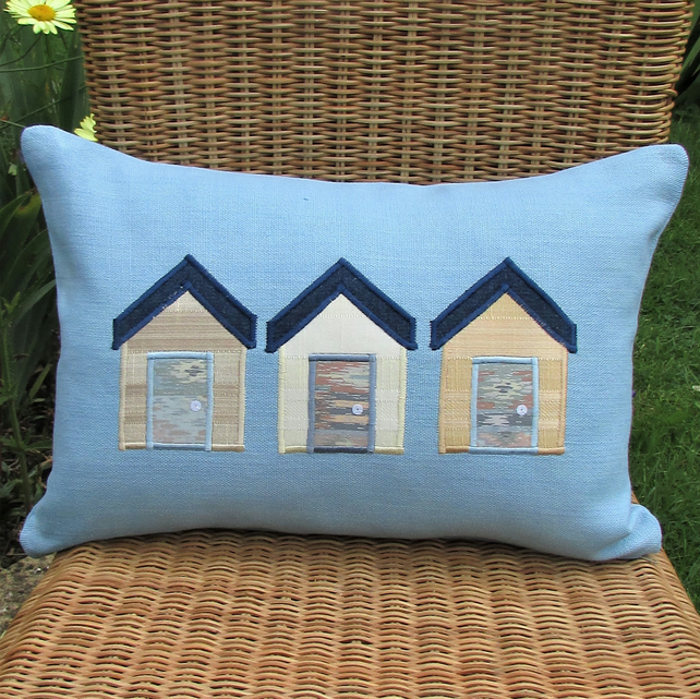 Beach huts cushion - Rectangular, blue with cream, beige and gold huts
