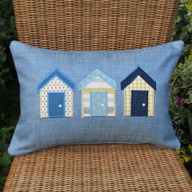 Beach huts cushion - Rectangular, blue with yellow, white, grey and blue huts