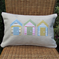 Beach huts cushion, rectangular, in cream with pastel blue, pink and yellow huts