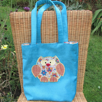 Owl tote bag in turquoise with pink, turquoise and yellow floral owl