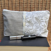 Large cream and beige leaf and stripe pattern cosmetic bag, make up bag
