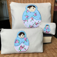 Russian doll stacking toiletry bag, cosmetic bag and purse with floral dolls