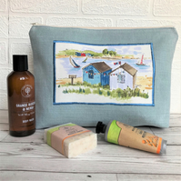 Beach huts toiletry bag, wash bag in pale blue with beach huts print panel