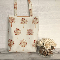 Woodland tote bag in cream with trees pattern in Autumn colours