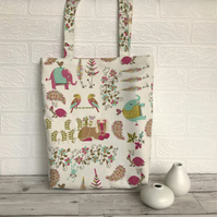 Tropical animals tote bag in cream with brightly coloured animals and flowers