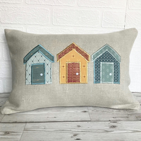 Beach huts cushion in cream with blue, golden-yellow and salmon huts