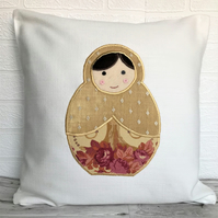 Russian doll cushion in cream with gold and pink Russian doll