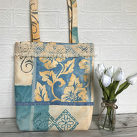 Boho-style patterned tote bag trimmed with lace and tasselled ribbon