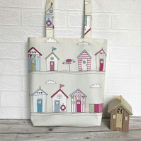 Beach huts tote bag in cream with pastel beach huts print pattern