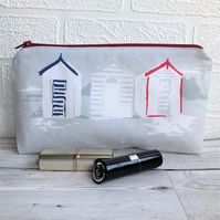 Cosmetic bag, make up bag in grey with blue, red and white beach huts