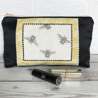 Large cosmetic bag, make up bag in black with bumble bees print panel