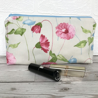 Cosmetic bag, make up bag in cream with pastel pink, blue and green floral print