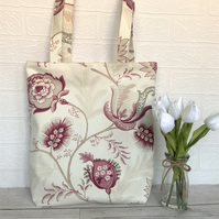 Pink patterned tote bag with large floral and paisley pattern