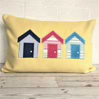 Beach huts cushion in lemon yellow with blue, white and pink beach huts