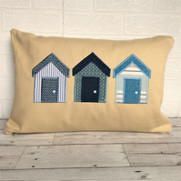 Beach huts cushion in golden yellow with blue and white beach huts