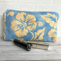 Cosmetic bag, make up bag in blue with golden yellow floral pattern