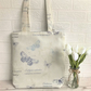 Butterflies tote bag in cream with blue butterflies