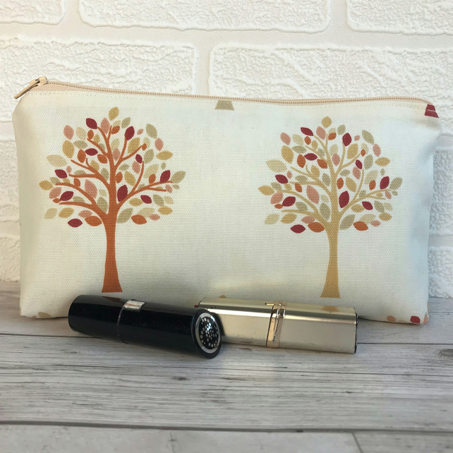 Cosmetic bag, make up bag in cream with trees pattern in Autumn colours