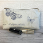 Cosmetic bag, make up bag in cream with blue butterflies