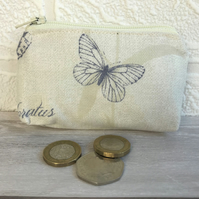 Small purse, coin purse in cream with small dark blue butterfly