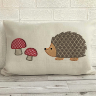 Hedgehog cushion in cream with brown lattice pattern hedgehog and red toadstools