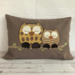 Sleepy owls cushion in brown and mustard