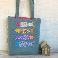 Fish tote bag in blue with four colourful floral fish