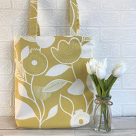 Tote bag in mustard and white stylised floral and foliage print fabric