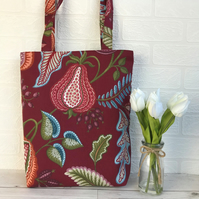 Burgundy tote bag with stylised fruit and foliage print