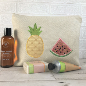 Tropical toiletry bag, wash bag in cream fabric with pineapple and watermelon