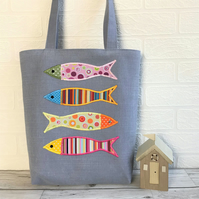 Fish tote bag in blue with four colourful circles and stripes patterned fish