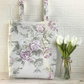 Pastel floral tote bag with sprays of lilac and white flowers