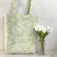 Pale green tote bag with white leaves, butterflies and flowers print