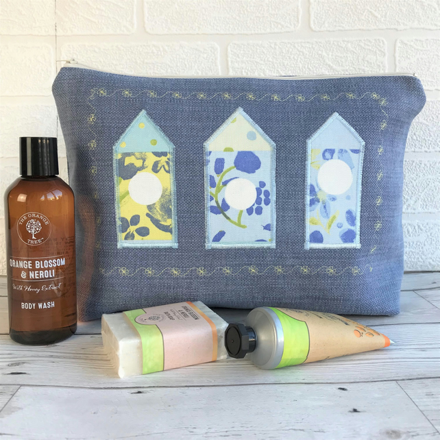 Birdhouse toiletry bag, wash bag in blue fabric with three floral birdhouses