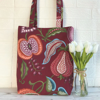 Tote bag with stylised fruit and foliage print in burgundy, pink and terracotta