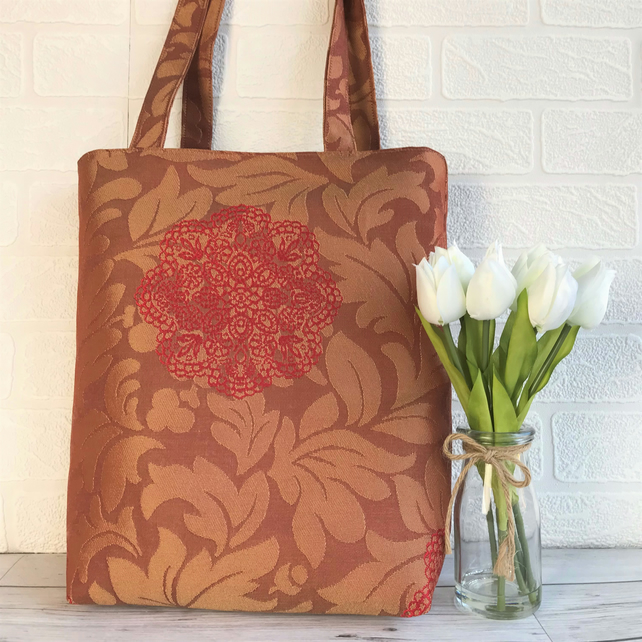 Terracotta leafy tote bag with red flower