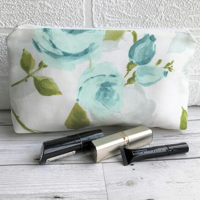 Cosmetic bag, make up bag in cream with pale blue roses and rosebuds