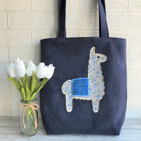 Llama tote bag in dark blue with ditsy floral llama and velvet textured blanket