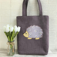 Lilac hedgehog tote bag with lilac daisy patterned hedgehog