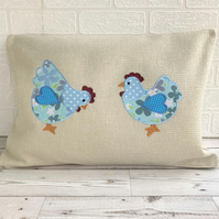 Chickens cushion with two pale blue floral and polka dot chickens