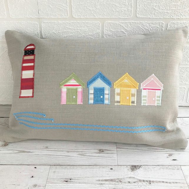 Lighthouse and beach huts cushion, rectangular cushion