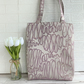 Lilac tote bag with lilac and mauve loops and swirls pattern